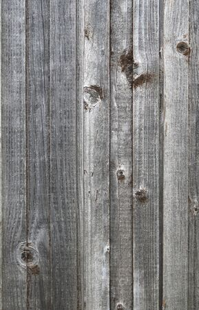 Texture boards of old gray wooden fence