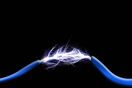Sparks between two wires on black background Stock Photo - 1979644