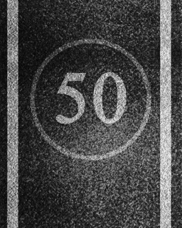 road paving: Speed limit Stock Photo