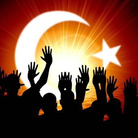 monotheism: some people celebrating beneath the islamic crescent moon Stock Photo
