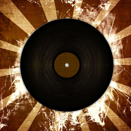 Old record plate on a grunge background with beams photo