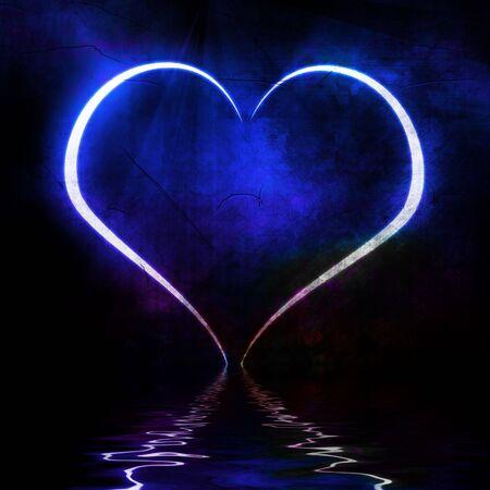 heartache: blue heart reflected in the ocean Stock Photo