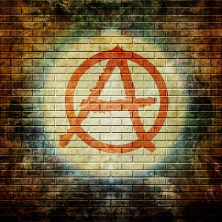 anarchy: grunge wall with anarchy symbol in graffiti Stock Photo