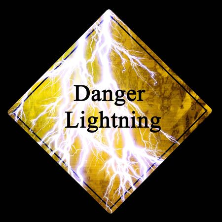 warning sign on a solid black background photo