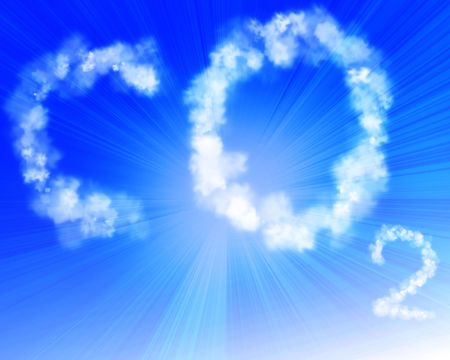 greenhouse effect: co2 written in the clouds in a clear blue sky Stock Photo