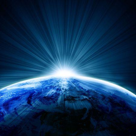 拡大: 日の出と宇宙から見た地球 写真素材