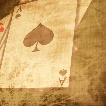 Vintage playing cards on a paper background with soft scratches photo