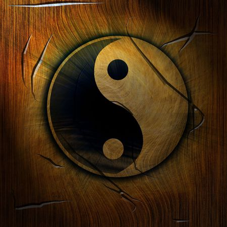 yin yang symbol on a wooden background photo