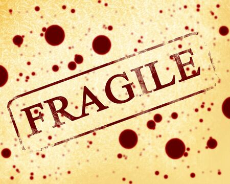 old fragile stamp on a paper background photo