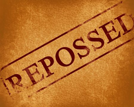repo: red stamp with reposessed written on it