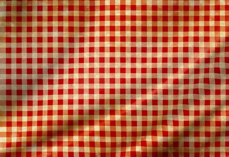 table cloth: red picnic cloth with some smooth folds in it Stock Photo