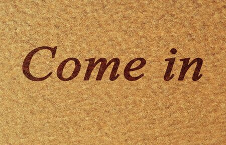 come in: door mat with come in written on it Stock Photo