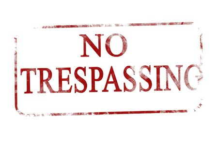 trespasser: old red stamp with no trespassing on it Stock Photo