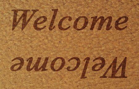 door mat with welcome written on it photo