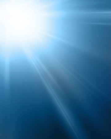 bright sun on a soft blue background photo