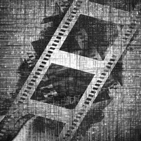 old film strip on a metal plate background photo
