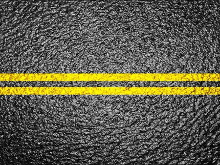 tar: Asphalt background texture with a double yellow line