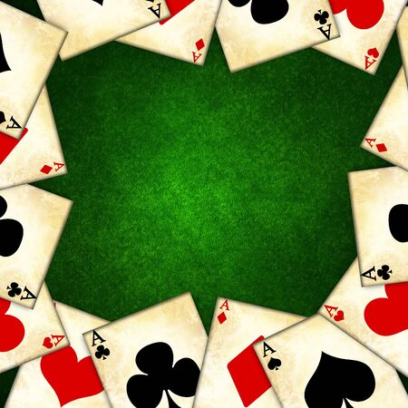 old playing cards on a green background photo
