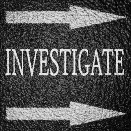 investigators: investigate written on an asphalt background texture