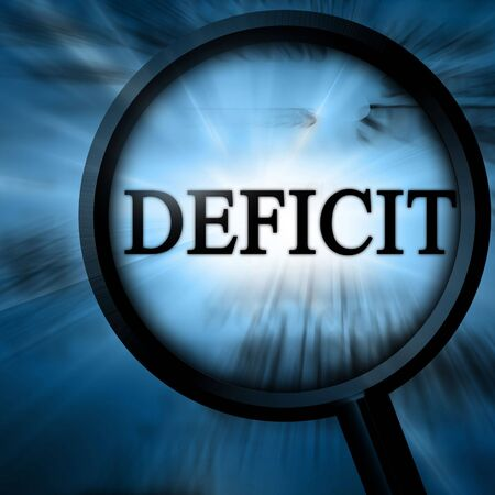 shortfall: deficit with magnifier on a blue background Stock Photo