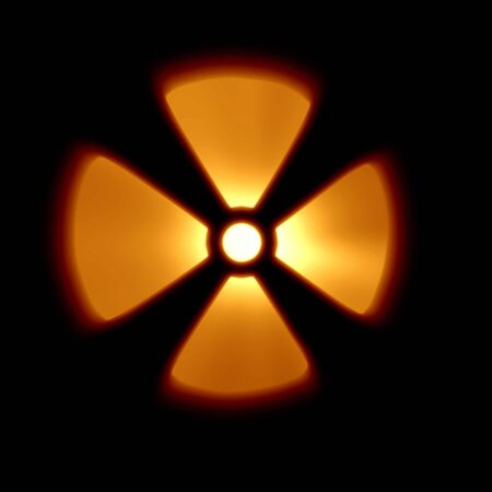 polution: Yellow nuclear warning sign on a black background