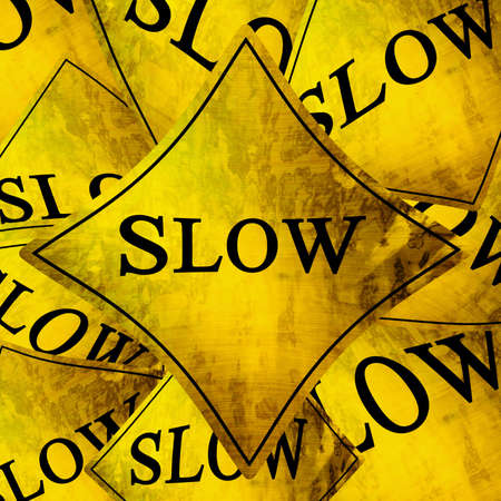 Slow signs with some damage on them photo