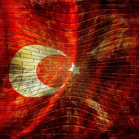 turkish flag painted on a brick wall photo