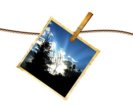 single old picture attached to a string Stock Photo - 5161097