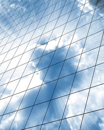 high rise buildings: high rise office building windows with reflected clouds Stock Photo
