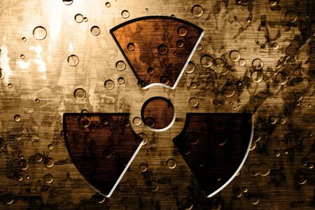 Grunge metal plate with a nuclear sign on it photo
