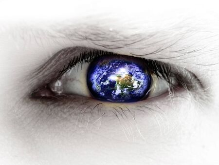 human eye with an integrated planet earth in it photo
