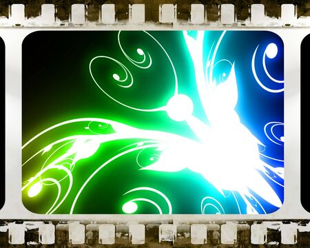 old film strip with an abstract butterfly in it photo