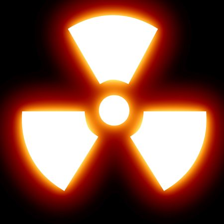nuclear sign on a dark black background Stock Photo - 5597975