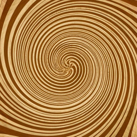 whirling: hypnotic swirl on a soft brown background Stock Photo