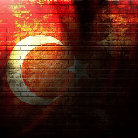 turkish flag painted on a grunge brick wall photo