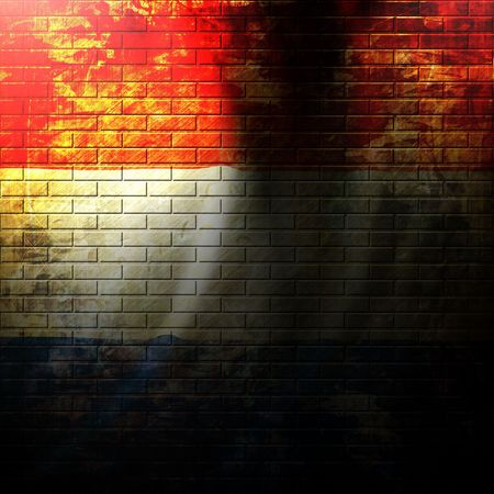 dutch flag painted on a grunge brick wall photo
