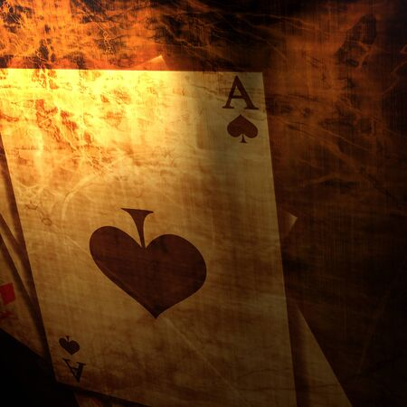 light play: Vintage playing cards on a paper background
