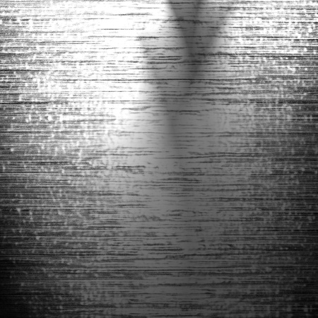 metal plate with reflected light on it photo
