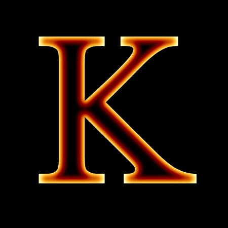 fire font: letter K on a dark background Stock Photo