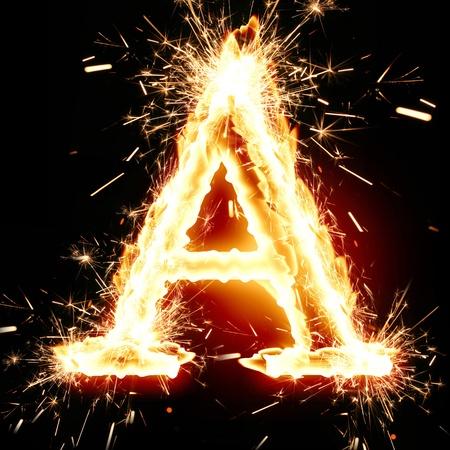 burning letter: sparkling font: letter A on a dark background Stock Photo