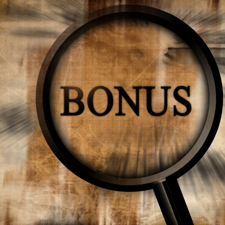bonus with magnifier on a brown background Stock Photo - 10342382