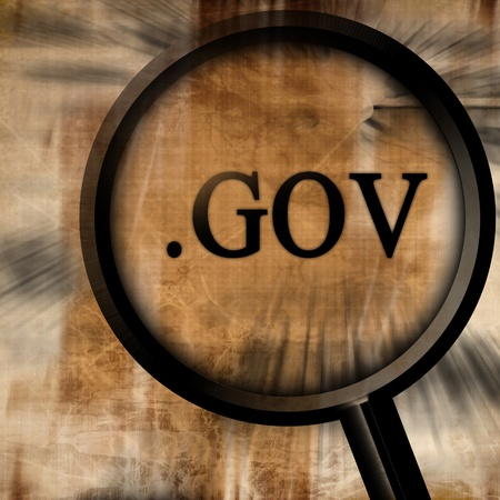 gov with magnifier on a brown background Stock Photo - 10342371