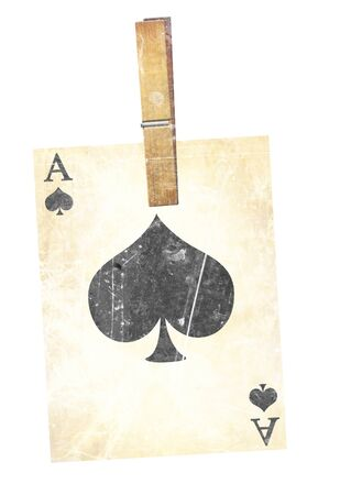 old playing card with wooden clothes peg photo