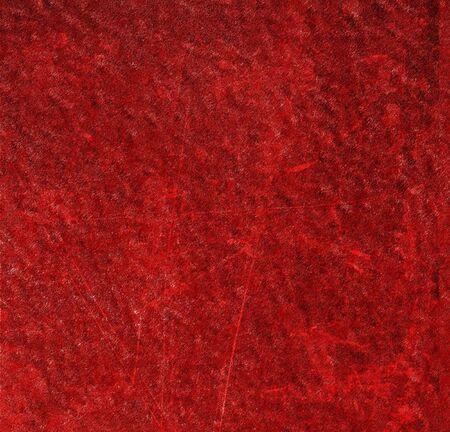 dirty carpet: close-up of the fibres of a red carpet