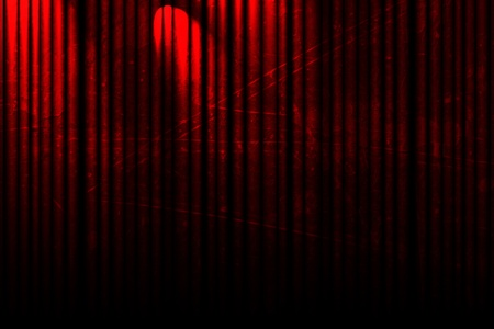 red movie or theatre curtain with a bright spotlight on it Stock Photo - 10340379