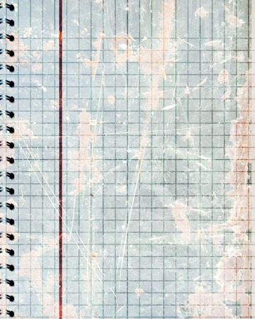 notebook with squares and a red line in it photo