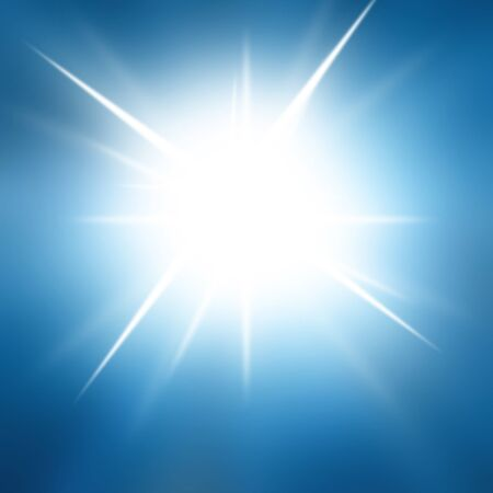 Intense sun on a soft blue background photo