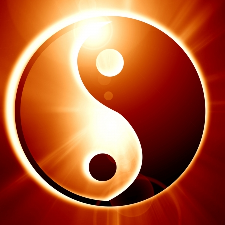 Yin Yang sign on a glowing background with some light rays photo