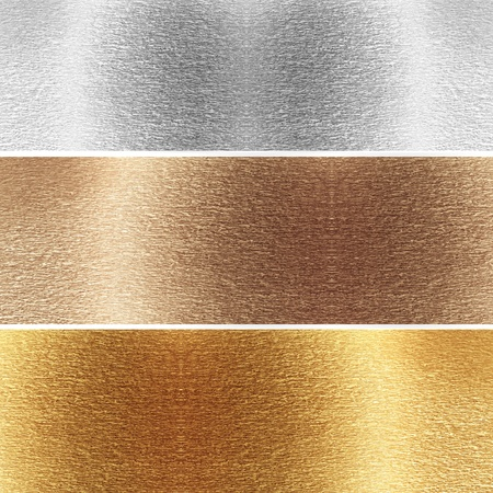 silver background: Aluminium, brass and golden plates with some reflected lights and reflections Stock Photo