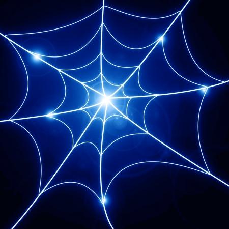 Glowing spider web on a dark background Stock Photo - 14840290